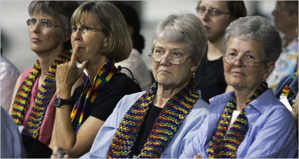 Women meeting last week at the Churchwide Assembly of the Evangelical Lutheran Church of America in Chicago wore rainbow scarves to support gay clergy members. (NY Times)